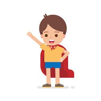 Счастливый милый мальчик одевается супергероя