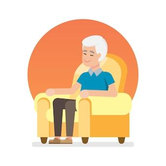 幸せな素敵な年配の男性が座っていると椅子でリラックス