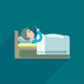 若い男がベッドの中でスマートフォンでテキストメッセージを使用して