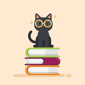 本の山の上に座ってかわいい猫