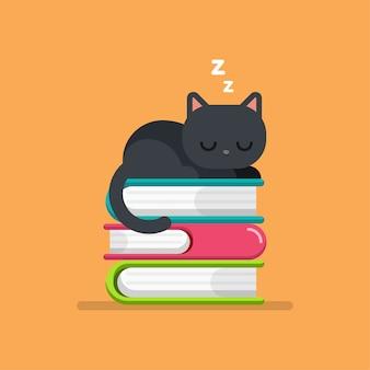 本の山の上で寝ているかわいい猫