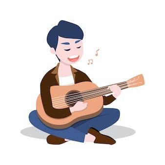 Счастливый молодой человек играет на гитаре и поет песню.