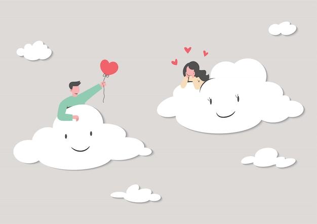 愛のメッセージを送信するクラウド上のかわいいカップル