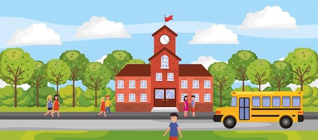 子供と学校の建物のシーン