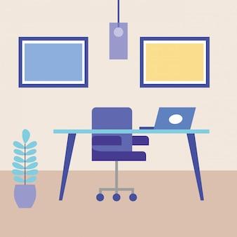 デスクのラップトップと椅子のあるオフィス