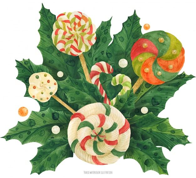 Рождественский букет падуба с леденцом и конфетой