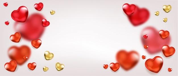 赤と金色のハートの風船とガラの背景