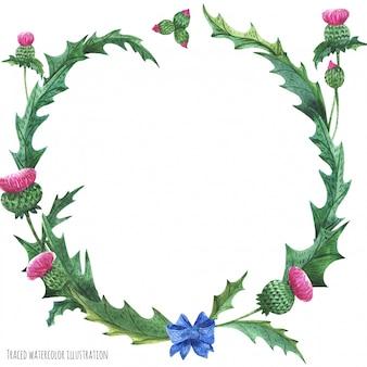 青い弓結び目とアザミの花輪