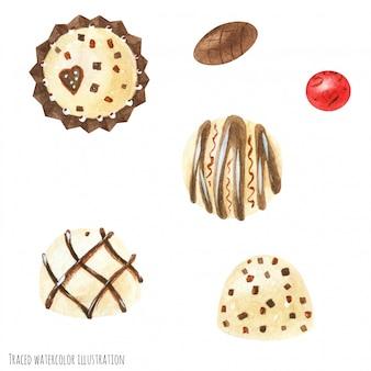 チョコレート菓子は白と金のアイシングを飾った