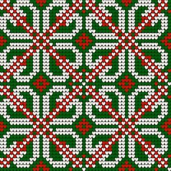 赤、緑、白の色でおばあちゃんのクリスマス編み物シームレスパターン