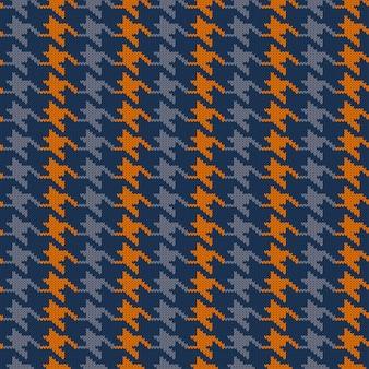 シームレスニットウールパターン千鳥格子。ビンテージブルーとオレンジの猟犬の歯のチェック