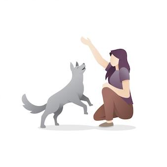 彼女の犬と遊ぶ若い女性
