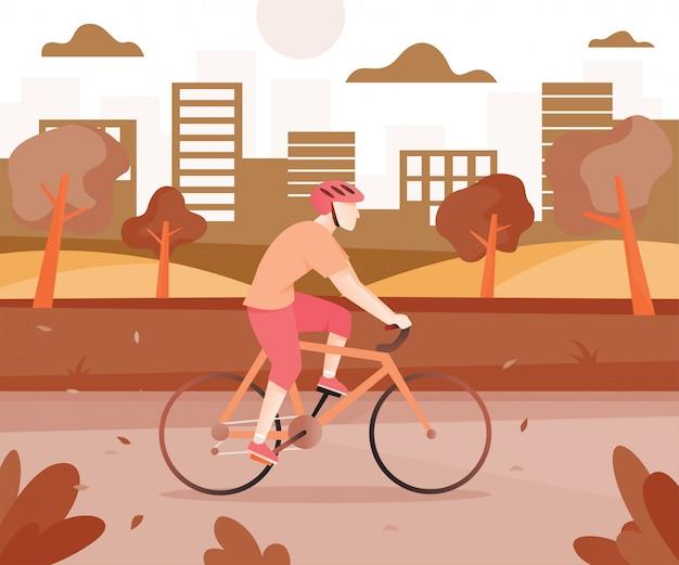 都市公園における自転車を持つ男性
