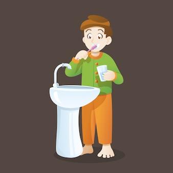 Маленький мальчик чистит зубы