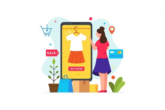 Женщина выбирает одежду и покупки с помощью смартфона