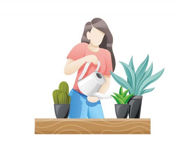 屋内植物の世話をする女性