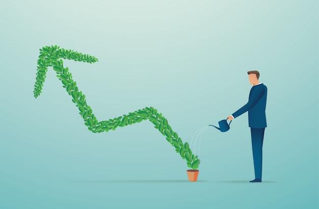 Бизнесмен поливает зеленую стрелку растений