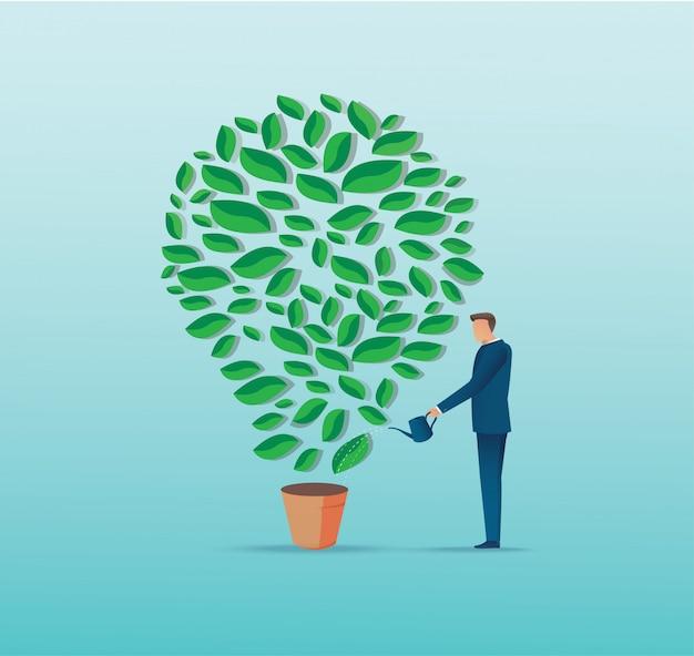 電球形植物に水をまく実業家