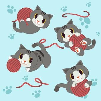 Маленькая кошка играет пряжу с фоном шага
