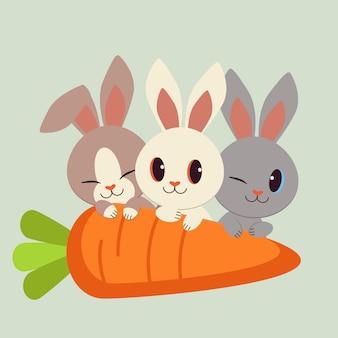 大きなニンジンとかわいいウサギのキャラクターのセット。