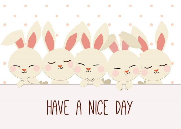水玉模様のウサギのグループ。良い一日を