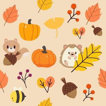 Узор из осенних листьев и диких животных. узор из листьев оранжевого и желтого тона.