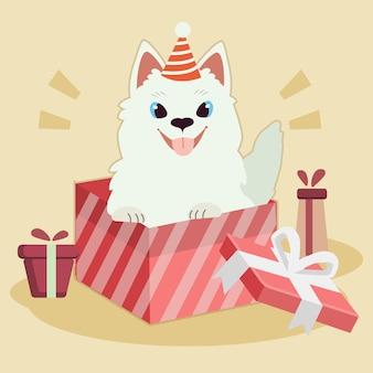 かわいいサモエド犬のキャラクターは、パーティの帽子をかぶり、大きなギフトボックスに座っています。