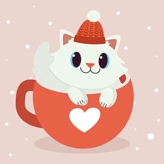 赤カップに座っているかわいい猫