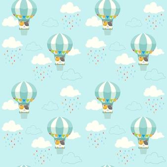 空の熱気球に座っているかわいい猫のシームレスなパターン。雲と雨のパターンが落ちる。