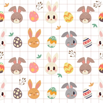 かわいいウサギとイースターエッグと葉のシームレスパターン