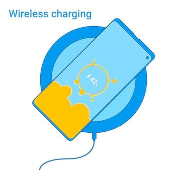 スマートフォンを充電パッドで充電します。
