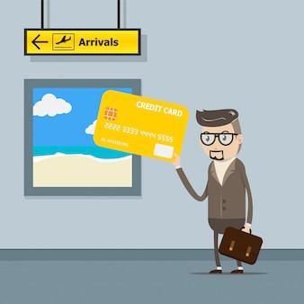 ビジネスマンは空港での旅行での支払いにクレジットカードを使用します。