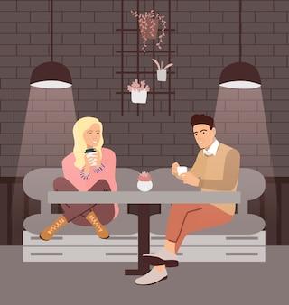 Пара пить кофе в кафе.