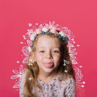 小さな女の子に花のいたずら書き