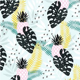 パイナップルの背景を持つ抽象的な熱帯の葉