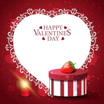 ギフトとイチゴの赤いバレンタインのグリーティングカード