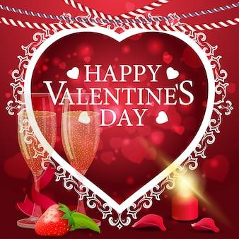 シャンパングラスと赤いバレンタインのグリーティングカード