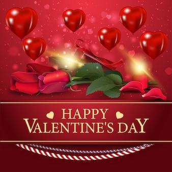バレンタインデーの花と赤いグリーティングカード