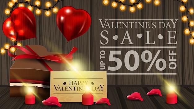 Горизонтальный баннер со скидкой на день святого валентина с шоколадной конфетой