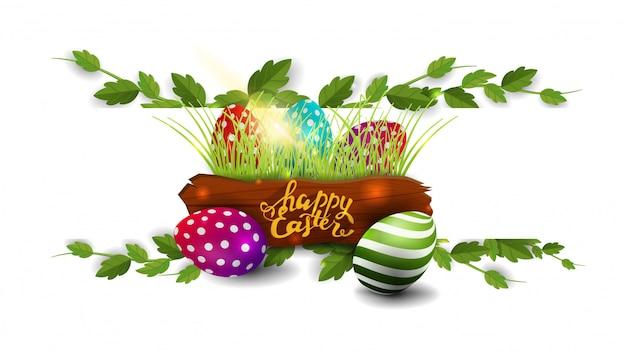 Счастливой пасхи, белая открытка с рамкой из лианы и пасхальных яиц