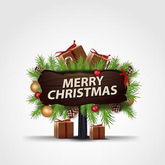 メリークリスマス。クリスマスツリーとギフトの木製プレート