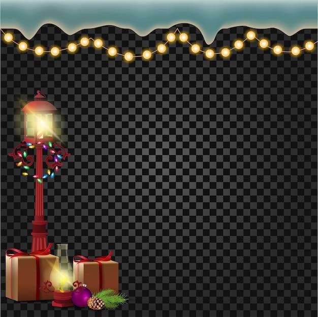 ギフトと花輪を持つ古い通りのランプ。クリスマスの装飾