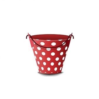 白で隔離水玉模様の赤いバケツ