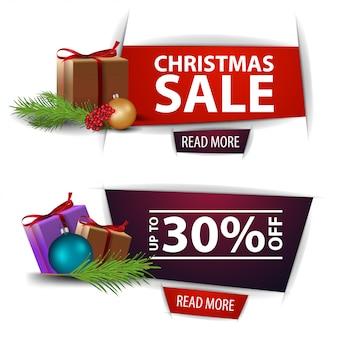 Рождественские скидки баннеры с подарками на белом фоне. красные и фиолетовые шаблоны