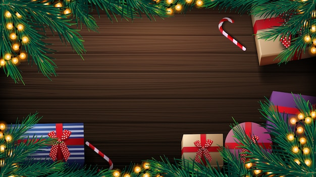 クリスマスの背景に木製のテーブル、プレゼント