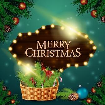 木製のサインとクリスマスバスケットのクリスマスカード