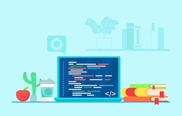 Рабочее место программиста написание кода на ноутбуке.