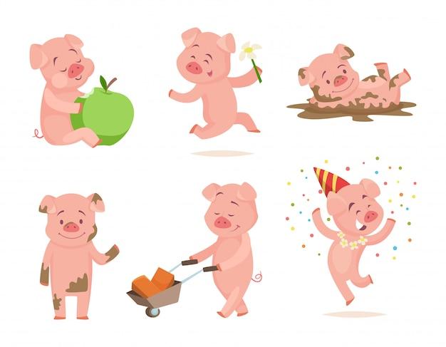 Веселые розовые свиньи играют в игры