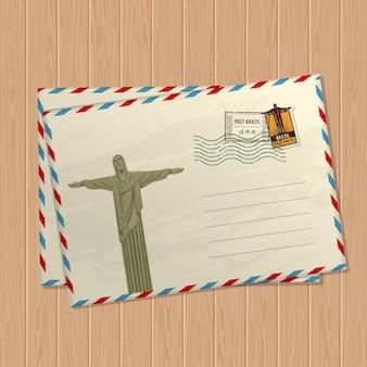 Открытка в винтажном стиле со статуей иисуса христа, знаками и марками бразилии