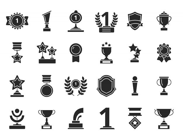 Победители трофеи иконки. кубки наградные медали с лентами черные силуэты изолированные